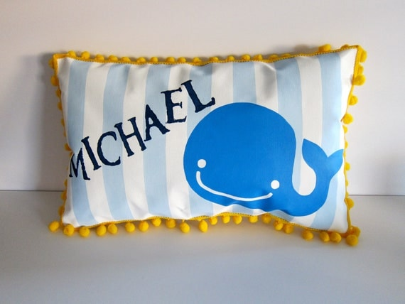 Baby pillow in baby blue stripes and bright blue whale accent.  Personalized with name.