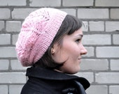 Knitted light pink woman beanie.