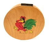 wooden hamburger patty press with rooster and chick