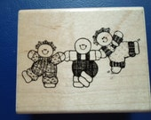 One mid size wood block rubber stamp with the design of cute round- ish children