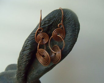 Copper dangle earrings wire wrapped into a double swirl drop