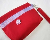 bright red cotton wristlet, purple lining, card slots and zip closure