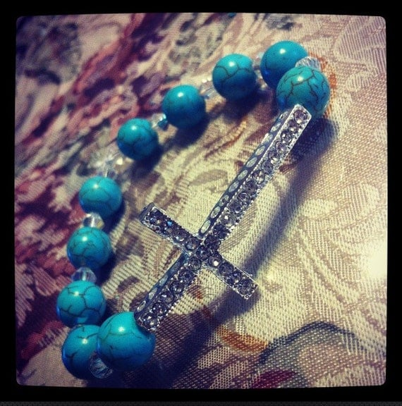 Silver crystal cross with turquoise stones