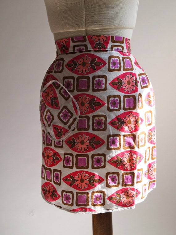 Vintage 70s kitsch pink, brown and purple floral apron with front pleat, trimmed pocket and ties.