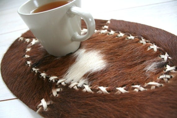 Cowhide placemats trimmed with leather, vintage home decor