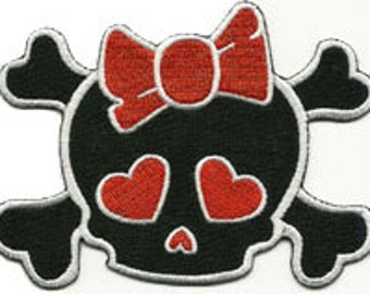 skull with red bow patch