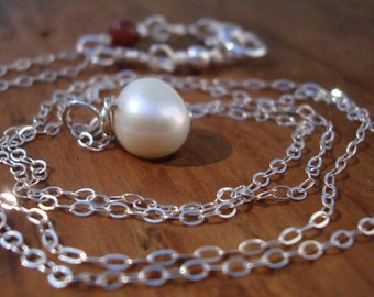 Morning Has Broken. freshwater pearl and delicate Sterling Silver cable chain.