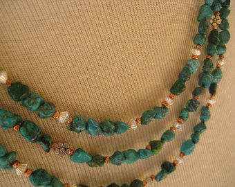 Necklace made with multiple strands of turquoise