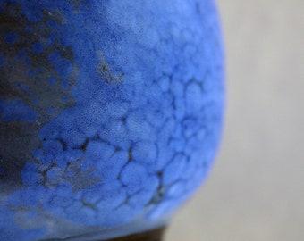 Round stoneware bowl with blue and grey glaze