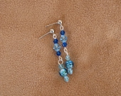 Silver tone post earrings with blue beads. Hangs 1 1/2 inches.