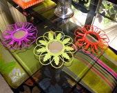 Three colorful flower shape mirrors