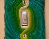 Wide Sargasso Sea green glow in the dark polymer clay switchplate