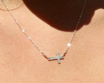 Tiny sterling silver sideways cross necklace