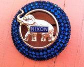 Political Richard Nixon elephant brooch with blue rhinestones