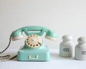 Aqua mint green vintage rotary telephone.