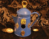 Great  repurposed material birdhouse made from a blue enameled coffee pot