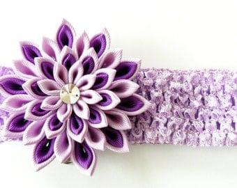 Crochet headband with Kanzashi fabric flower. Purple and orchid.