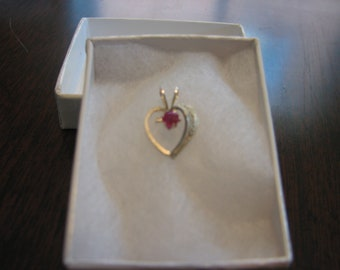 Ruby .25 carat mounted in a sterling Silver Heart Pendant.