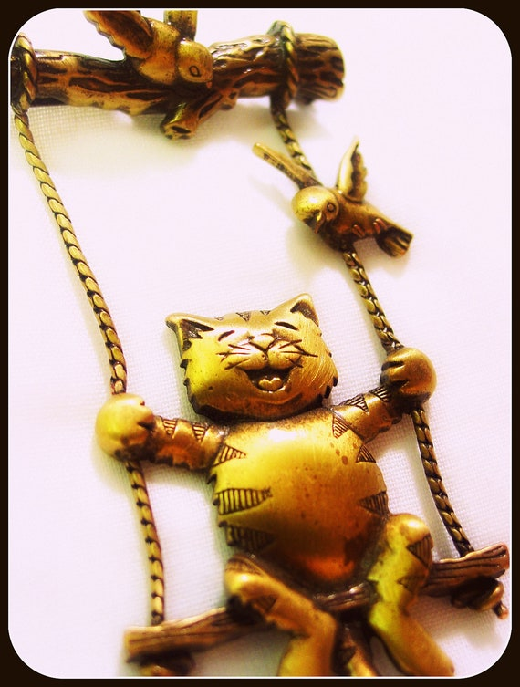 Happy Cat (signed JJ gold tone vintage  brooch, cat on swing with birds)