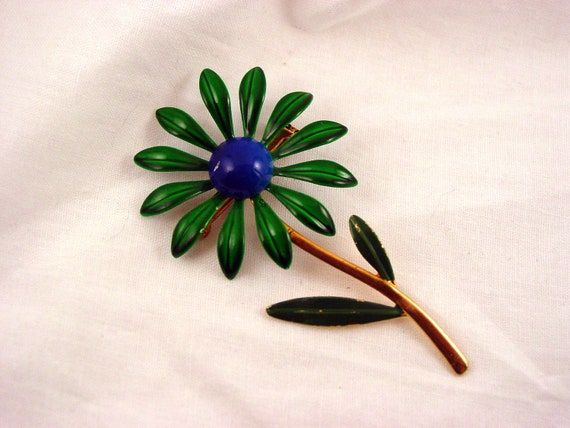 A Fetching Flower (big vintage flower brooch with green leaves and petals, blue center, gold tone, 50s, 60s)
