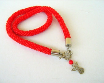 Crochet necklace.  Crochet rope necklace. Poppy red bead crochet rope and angel symbol .