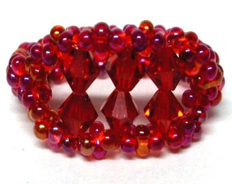 Beaded crystal ring red fluorescent beads with 6 5mm swarovski crystals on a stretchy cord