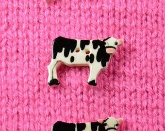Handpainted ceramic cow buttons, x3