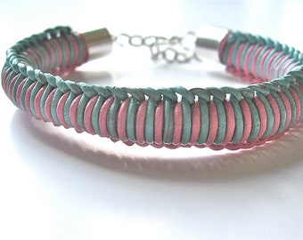 woven leather bracelet in baby blue and baby pink with silver hardware