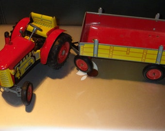 Red and Yellow Tractor and Trailer
