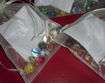 Individual bags of vintage marbles