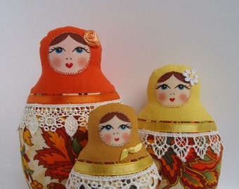 A Set of Orange Yellow cloth Matryoshkas (Russian babushka dolls)