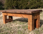 Farmhouse style bench made of reclaimed wood.