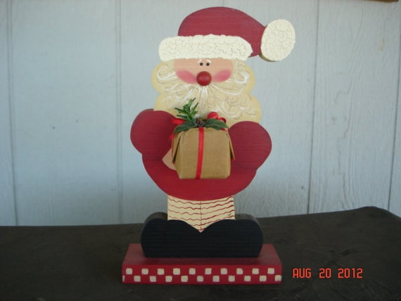 Wooden Santa Claus Holding A  Present