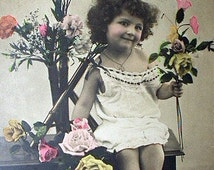 RPPC Postcard Curly Hair Little Girl Holding Flowers Used Real Photo All Smiles France Antique 1907 Paper Real Art Photograph