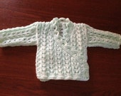 baby's hand knitted cross over cardigan, crafted from double knitting wool, available in variety of colours