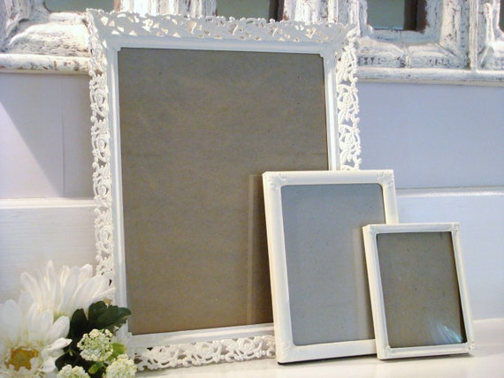 vintage metal frames, white frames, frame collection, shabby chic frames