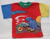 Vintage 90s Child's Dinosaur Shirt w/ Dino Rangers by Buster Brown in Primary Colors - Size 2T