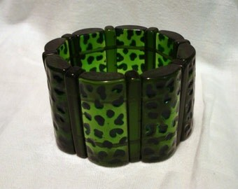 Clearance Lucite plastic bracelet leopard print translucent and opaque green bars stretch bangle vintage