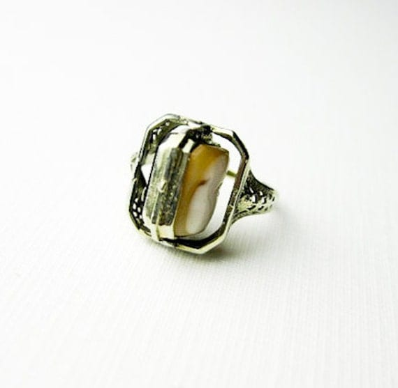 Sold to FlyingFoxCrafts Art Deco, Filigree, 14K White Gold, Swivel Ring, USA 1932, Cameo and Onyx.