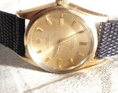Rolex,Oyster perpetual vintage gold watch