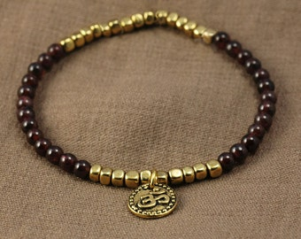 Little Doña women collection - garnet and brass beads, tibetan OHM charm