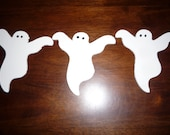 Three hand-painted wood ghosts. Just in time for Halloween