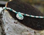Silver champagne n Teal seed bead necklace with silver pendant with paper and glass beads