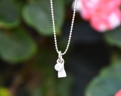 Custom made tooth pendant and sterling silver chain