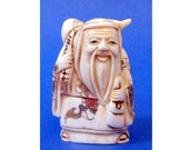 Antique Japanese Ox Bone Netsuke With Happy Man Carry Pumkin