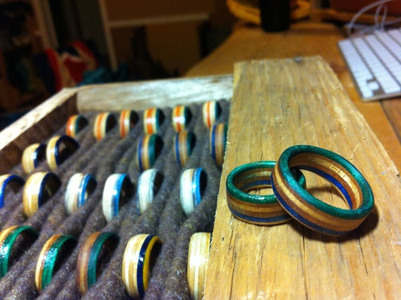Rings with a  green & blue stripe hand cut from skateboard decks