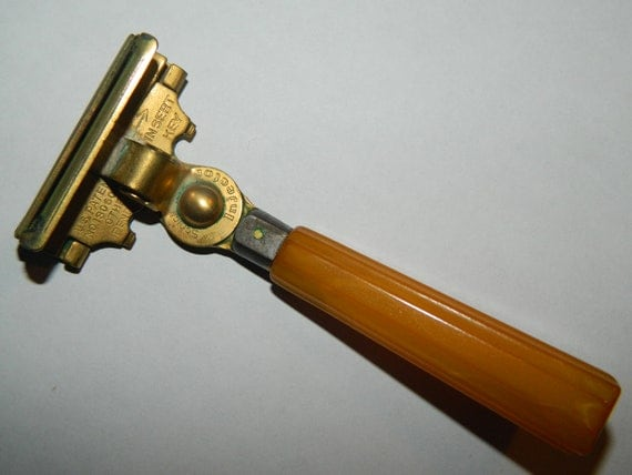 Vintage 1940's mens Schick shaving safety razor with a buttersctoch bakelite handle
