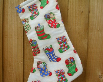 Cream Christmas Stocking with small stockings fabric.  Lined with cream fabric.