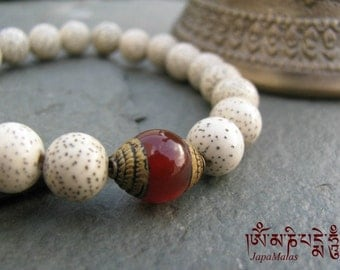 Lotus seed Bracelet Mala with capped carnelian guru bead purified & blessed mala