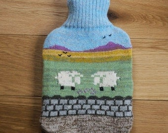 Knitted hot water bottle cover with countryside design: bottle included